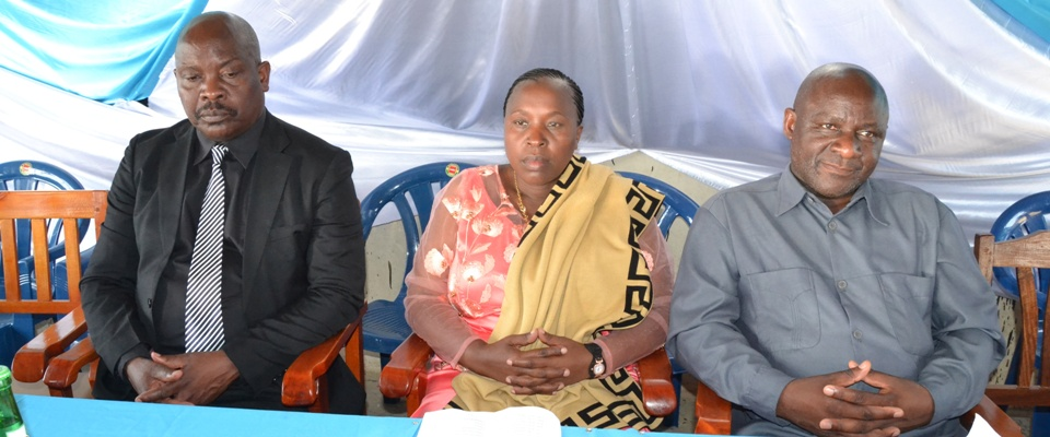 Chairman of School Board, Guest of Honour, and School Director paying attention to various events during 2018 Graduation Ceremony.
